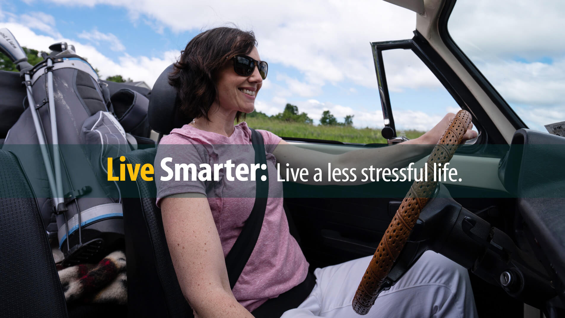 Smiling woman driving convertible is happy with a less stressful life managing her debt